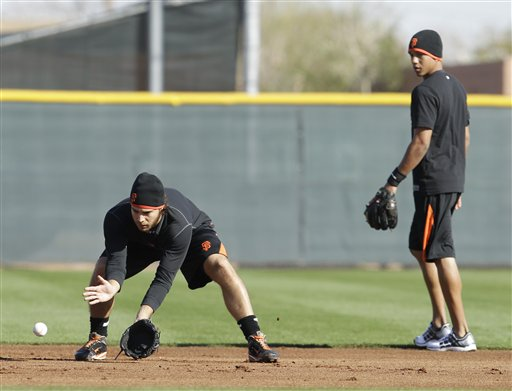 Ehire Adrianza, right, works out with Brandon Crawford at Giants spring training. Adrianza is a prospect to watch this spring.