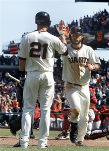 San Francisco Giants' Brandon Crawford, right, celebrates after hitting a solo home run off Arizona Diamondbacks pitcher David Hernandez with teammate Nick Noonan (21) during the ninth inning of a baseball game in San Francisco, Wednesday, April 24, 2013. (AP Photo/Jeff Chiu)