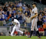 San Francisco Giants starting pitcher Barry Zito waits for a new ball as Milwaukee Brewers' Yuniesky Betancourt rounds the bases after hitting a grand slam during the third inning of a baseball game Tuesday, April 16, 2013, in Milwaukee. (AP Photo/Morry Gash)