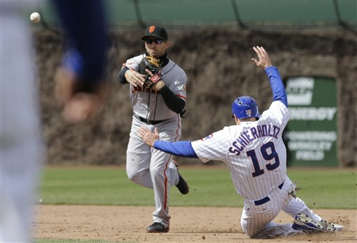 Chicago Cubs' Nate Schierholtz, right, is out as San Francisco Giants second baseman Marco Scutaro throws to first during the eighth inning of a baseball game in Chicago, Saturday, April 13, 2013. Welington Castillo was out at first. (AP Photo/Nam Y. Huh)