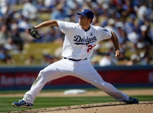 Los Angeles Dodgers starting pitcher Clayton Kershaw throws during the fourth inning of a season opening baseball game against the San Francisco Giants in Los Angeles, Monday, April 1, 2013. (AP Photo/Jae C. Hong)