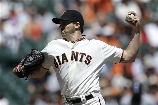 San Francisco Giants pitcher Barry Zito delivers against the Colorado Rockies during the first inning of a baseball game in San Francisco, Wednesday, April 10, 2013. (AP Photo/Jeff Chiu)