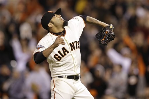 San Francisco Giants pitcher Sergio Romo (54) celebrates after striking out Colorado Rockies' Wilin Rosario to end the ninth inning of a baseball game in San Francisco, Monday, April 8, 2013. The Giants won 4-2. (AP Photo/Jeff Chiu)