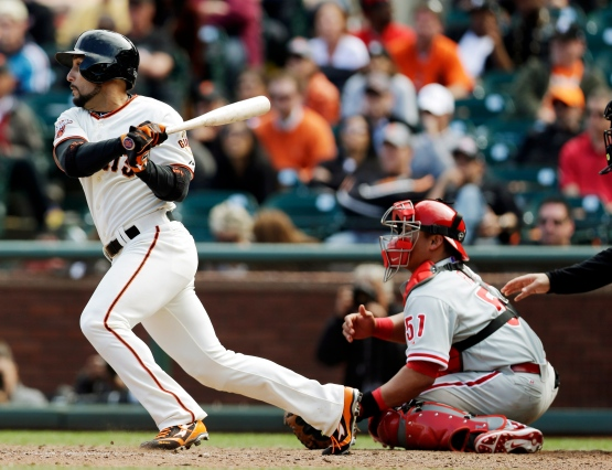 San Francisco Giants' Andres Torres drives in the winning run with a single against the Philadelphia Phillies in the 10th inning of a baseball game, Wednesday, May 8, 2013, in San Francisco. San Francisco won 4-3. (AP Photo/Marcio Jose Sanchez)