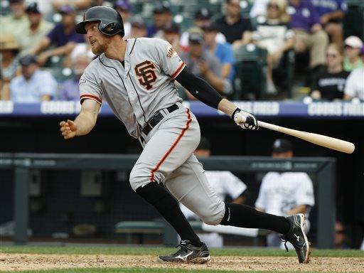 San Francisco Giants' Hunter Pence singles against the Colorado Rockies in the ninth inning of the Giants' 5-2 victory in a baseball game in Denver on Sunday, June 30, 2013. (AP Photo/David Zalubowski)