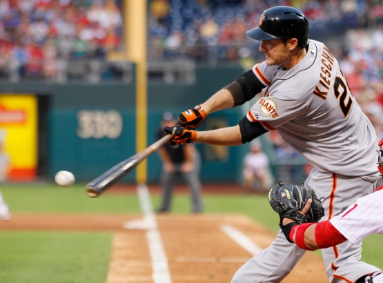 San Francisco Giants' Roger Kieschnick hits a single that scored Buster Posey from third base during the third inning of a baseball game against the Philadelphia Phillies, Wednesday, July 31, 2013, in Philadelphia. (AP Photo/Tom Mihalek)