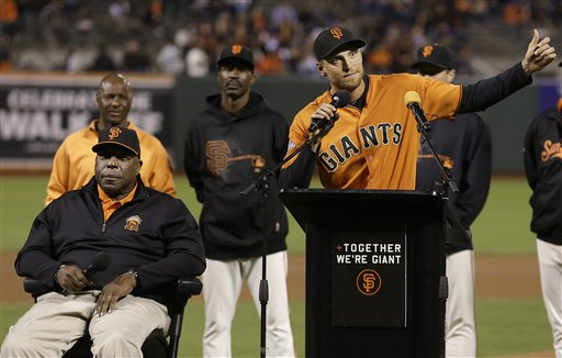 San Francisco Giants right fielder Hunter Pence, right, gestures while speaking after being announced as the 2013 winner of the Wille Mac Award, named after former Giant Willie McCovey, seated left, before a baseball game against the San Diego Padres in San Francisco, Friday, Sept. 27, 2013. (AP Photo/Jeff Chiu)
