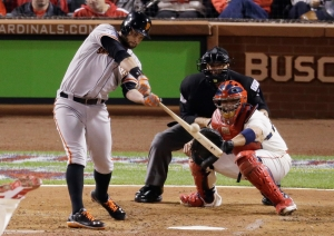 San Francisco Giants' Brandon Belt hits a sacrifice fly during the third inning in Game 1 of the National League baseball championship series against the St. Louis Cardinals Saturday, Oct. 11, 2014, in St. Louis. (AP Photo/Eric Gay)